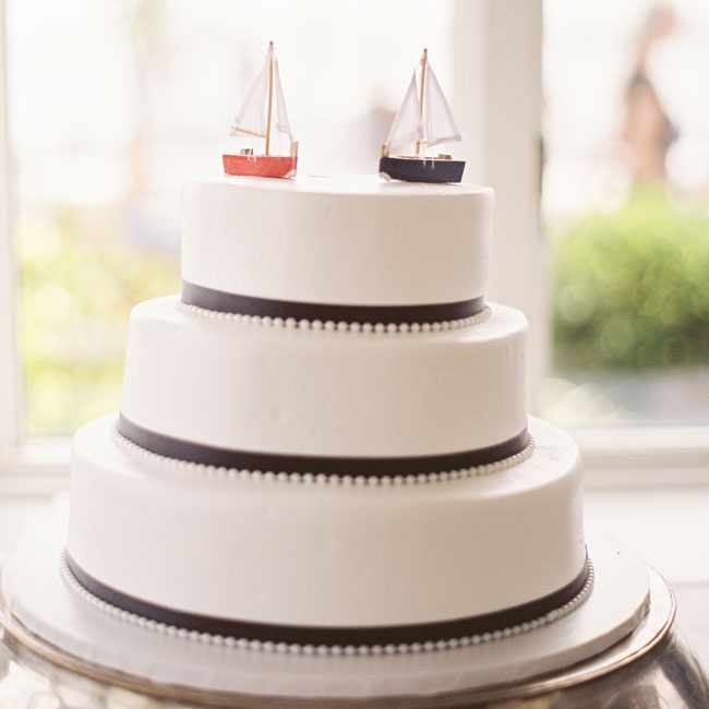 A red and blue sailboat completed the nautical Americana wedding cake.