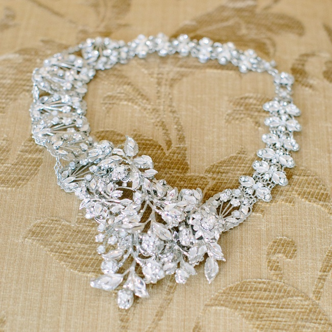 Ally wore this unique crystal statement necklace with a floral motif down the aisle on her wedding day.
