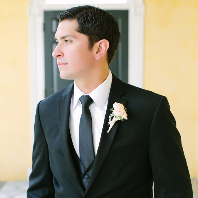 Jeff wore a classic black tux and accessorized with a black vest and tie and finished it all off with a peach boutonniere.