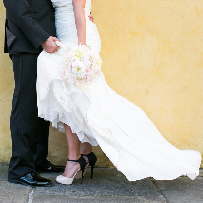 Ally wore these interesting black and white peep-toe heels down the aisle on her wedding day.