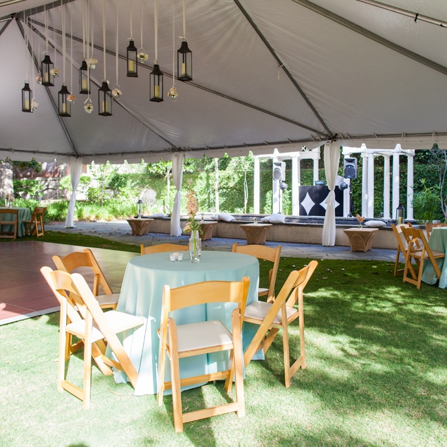The reception space was tented and featured hanging candlelit lanterns.