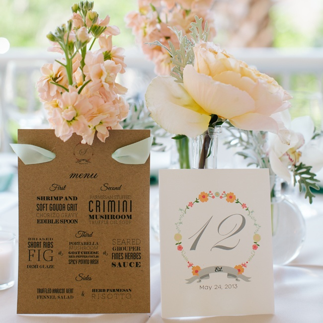 A graphic neutral menu card was set in the middle of the table along with a formal table name with a floral motif.
