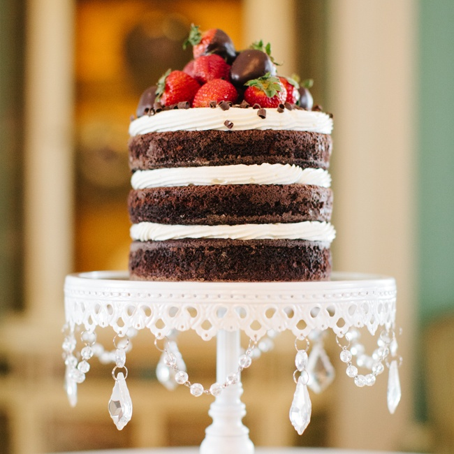 The couple chose to have a trendy naked chocolate cake with buttercream frosting between layers and topped with chocolate-covered strawberries.