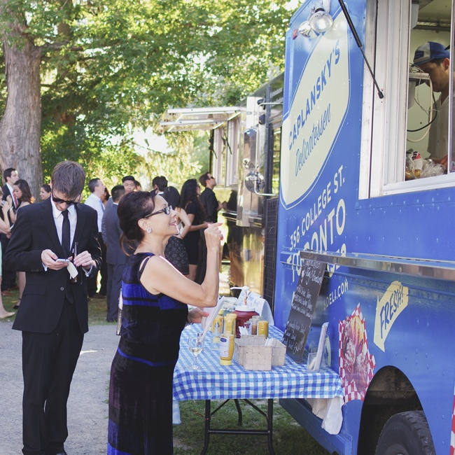Rather than hosting a traditional sit down dinner, the couple brought in a bundle of food trucks to cater the event for a fun, unique experience that fit perfectly with the outdoor venue.