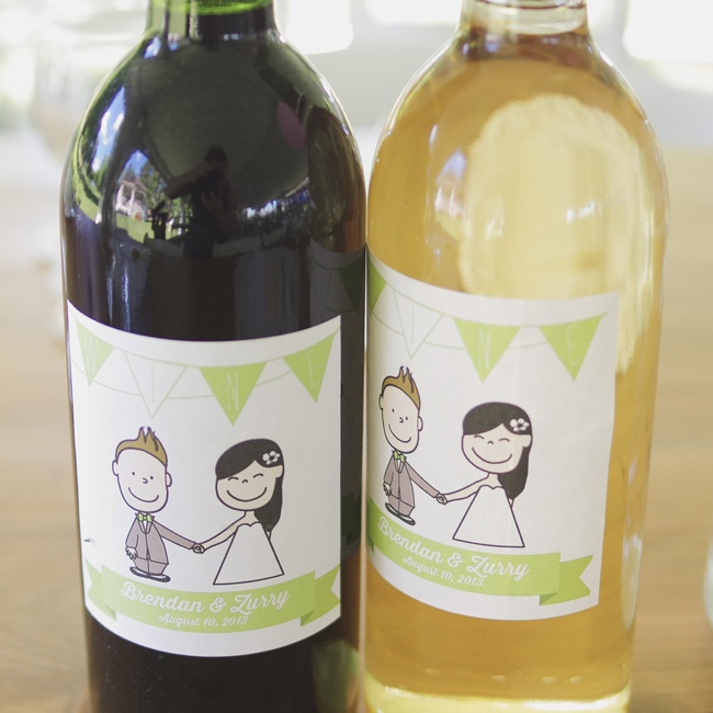 Each reception table was provided with a bottle of red and white wine decorated with a custom label designed by Zurry to match the couple's invitations.