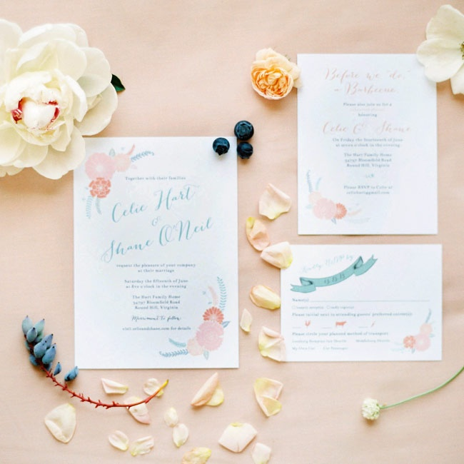 The couple's invitation suite featured a sweet floral motif in peach, blush and light blue to coordinate with the bride's color palette.
