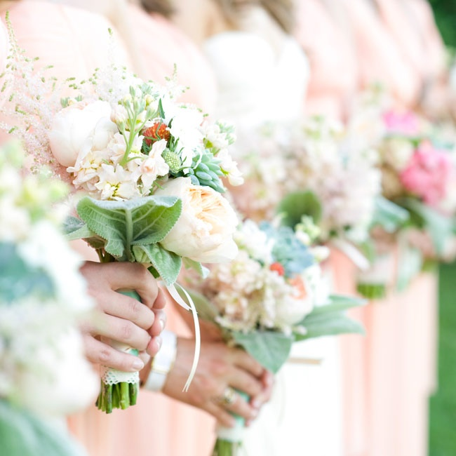 Bridesmaids carried elegant bouquets of peonies and lamb's ear down the aisle.