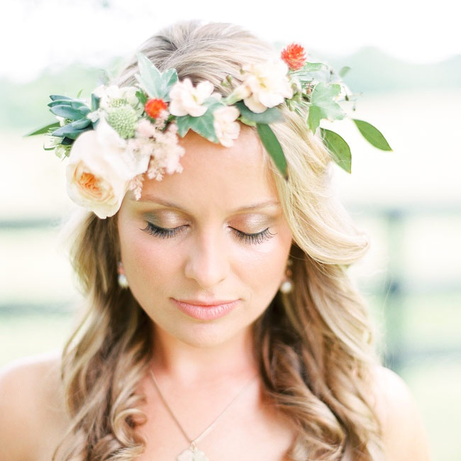 The bride wore a custom floral crown made of fresh blooms in lieu of a veil.