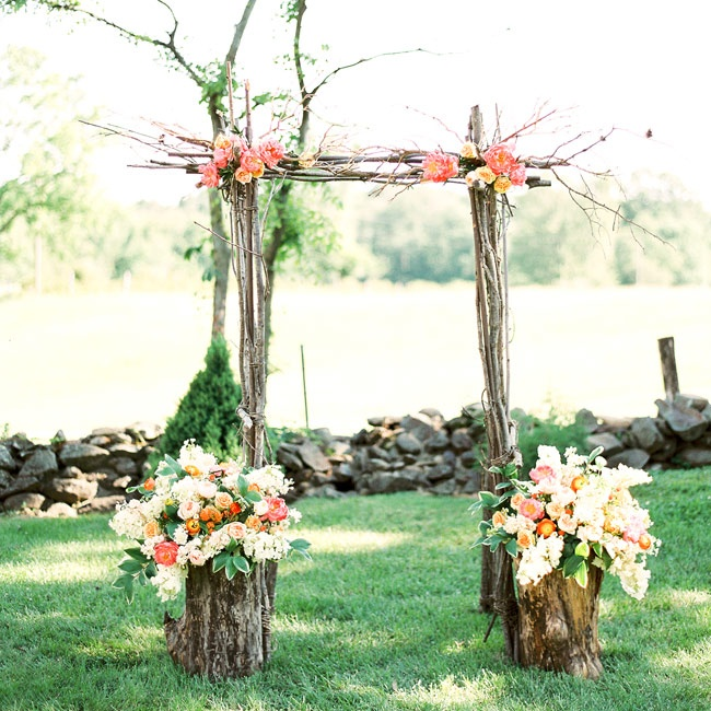 In lieu of a traditional ceremony arch, the couple opted for this whimsical set up made of tree branches and fresh flower blooms.
