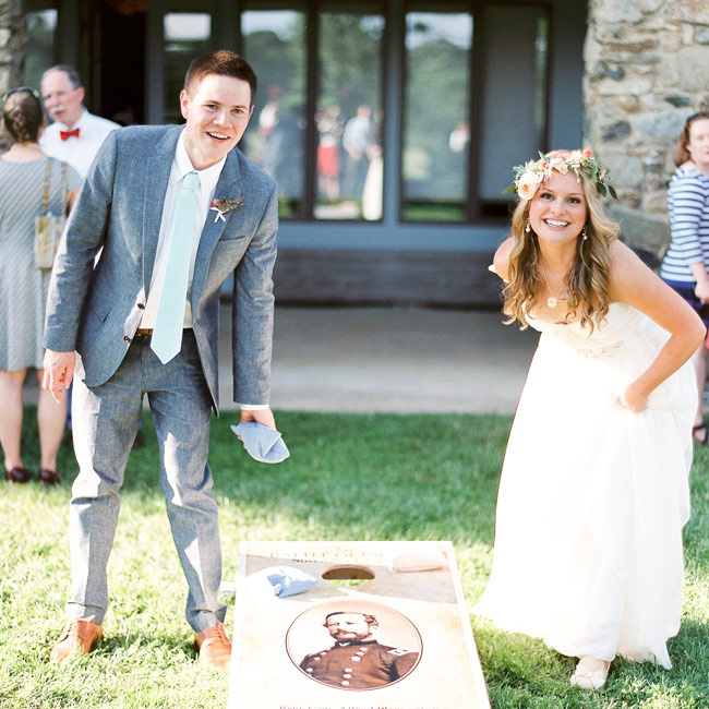 The bride and groom played the classic lawn game corn hole during cocktail hour with family and friends.