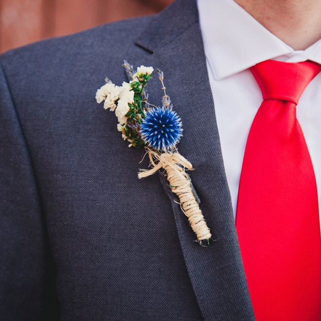 Susie made Kurt's rustic boutonniere of bright blue globe thistle and sinuata statice with dried flowers she found on Etsy.