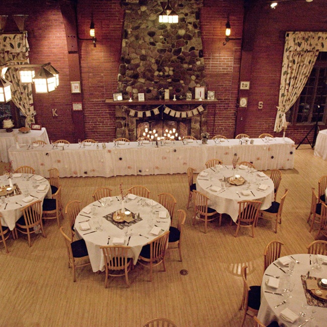 The couple hosted their reception at the Hubbard Park Lodge. The exposed brick and stone fire place added a rustic flair that complemented the day's theme.
