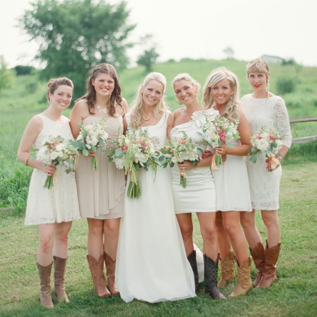 Nikki's bridesmaids wore their own dresses in neutral colors, which they paired with cowboy boots that complemented the wedding's country motif.