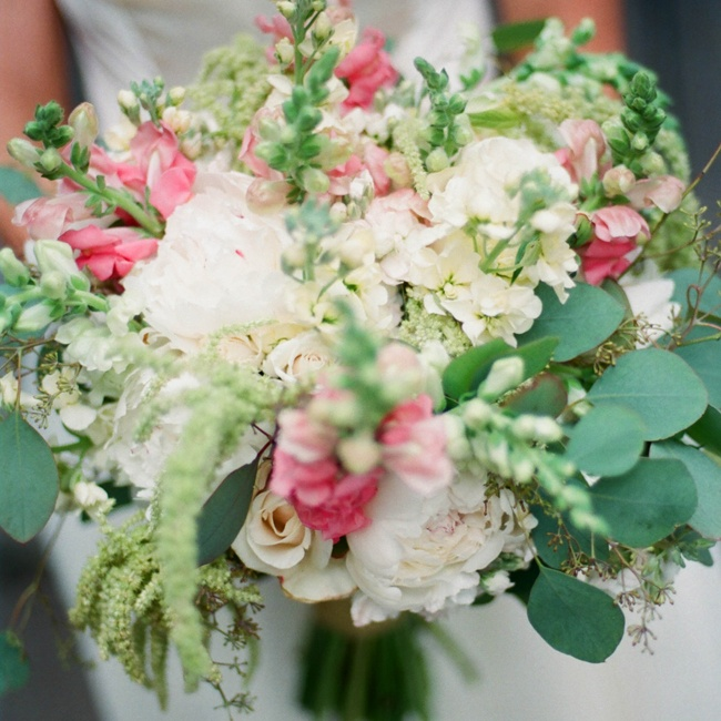 Nikkie designed her bouquet herself with flowers she bought wholesale from Market Flowers in Minneapolis, MN. She mixed astilbe, snapdragons, roses, peonies and eucalyptus to create a romantic, rustic bouquet.