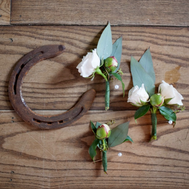 Nikki and her bridesmaids made all of the boutonnieres for Robbie and his groomsmen. The boutonnieres consisted of white roses and eucalyptus leaves.