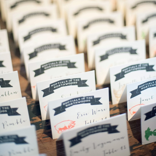 Nikki designed each of the country fair-themed escort cards. Each card was stamped with an animal, representing one of the reception tables.