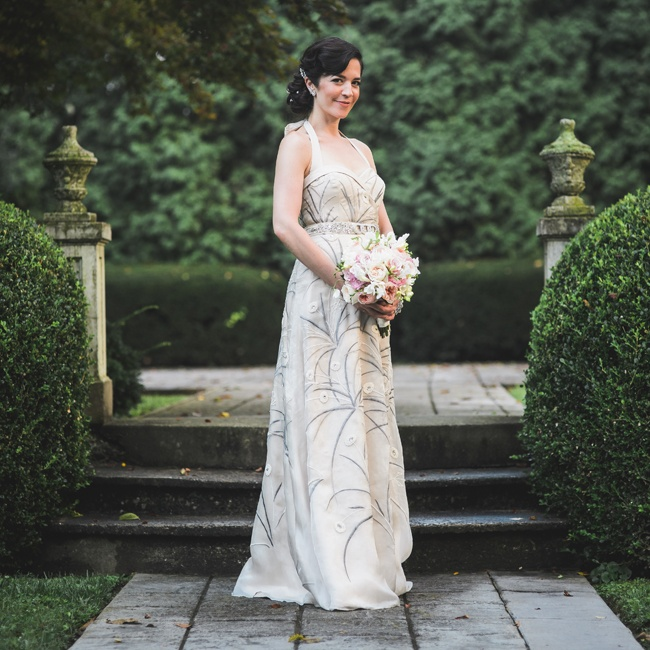 Amanda's champagne gown from BHLDN was the perfect match for her vintage-inspired look with it's flirty mid-century cut. The gown's organdy overlay with embroidered ferns and French-knotted buds added a soft feminine touch to the look and complemented the elegant garden setting.