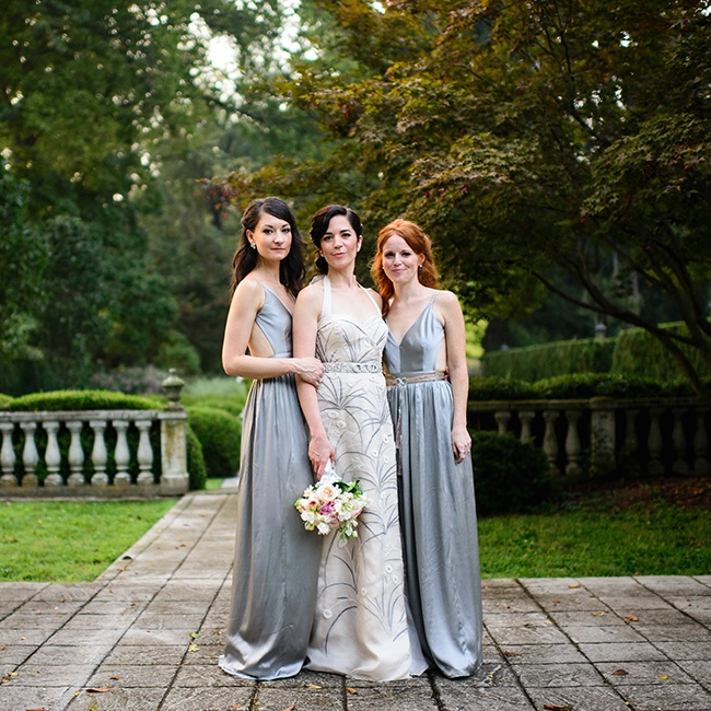 Amanda's bridesmaids wore long silk maxi dresses featuring deep V-necks and open backs. The gowns played on the style of 1930's evening gowns, befitting of the day's vintage inspiration.