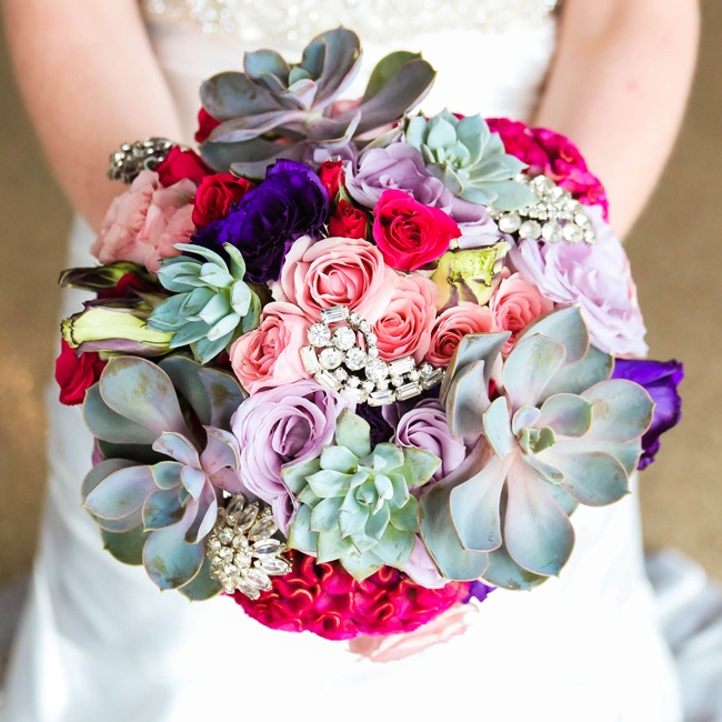 Amanda carried a bright bouquet of pink, red and purple roses. Succulents added and element of texture to the mix, while crystal brooches added a bit hint of glam.