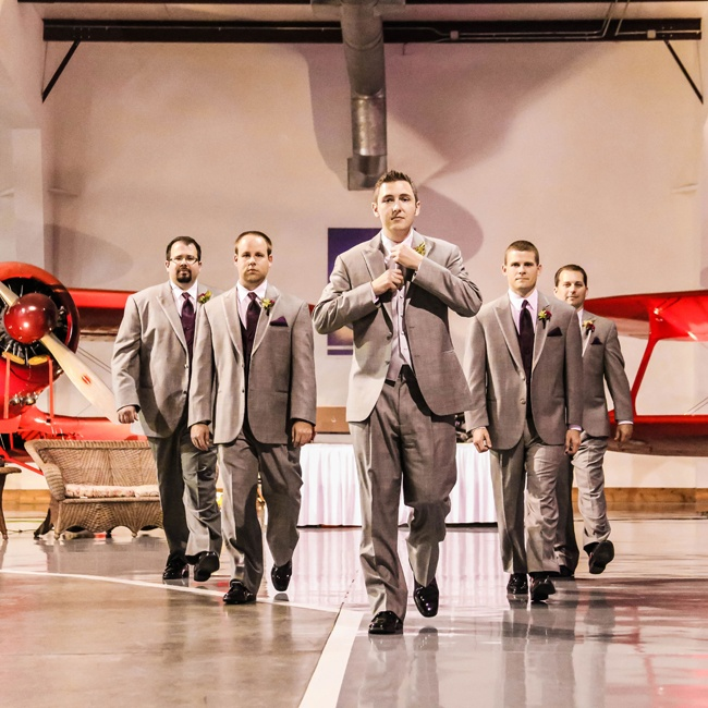 Justin and his groomsmen looked sharp in matching light gray linen suits and deep burgundy ties.