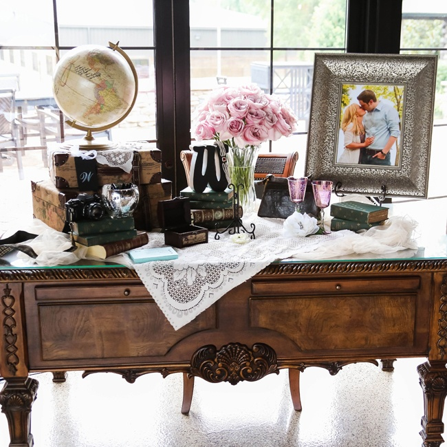 Amanda and Justin incorporated vintage props into the decor that went along with the historic nature of their reception location. The antique desk displayed their guestbook, antique books and a photo of the couple.