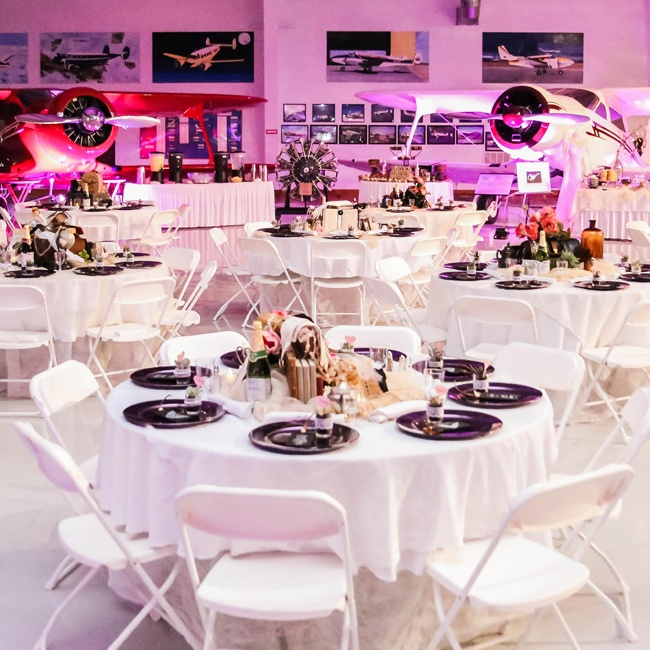 The museum interior, laden with antique aircraft and artifacts, added a modern edge to the reception decor. Purple uplighting heightened the effect and gave off a futuristic vibe.