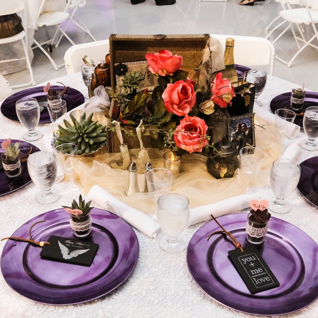 Modern and vintage elements came together for the reception centerpieces. Each centerpiece was unique and combined antiques, votive candles and bright blossoms. Each place was set with a purple charger topped with a miniature succulent favors.