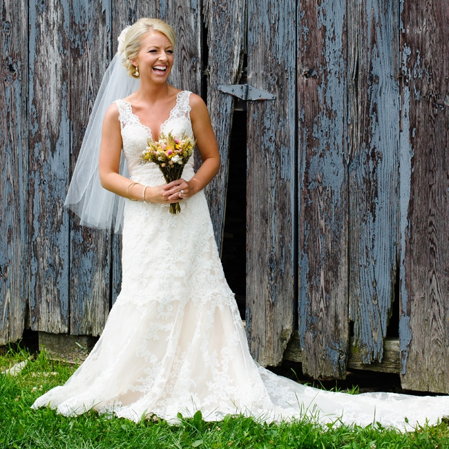 Lysa wore an elegant A-line lace gown with a a v-shaped neckline by Allure Bridal.