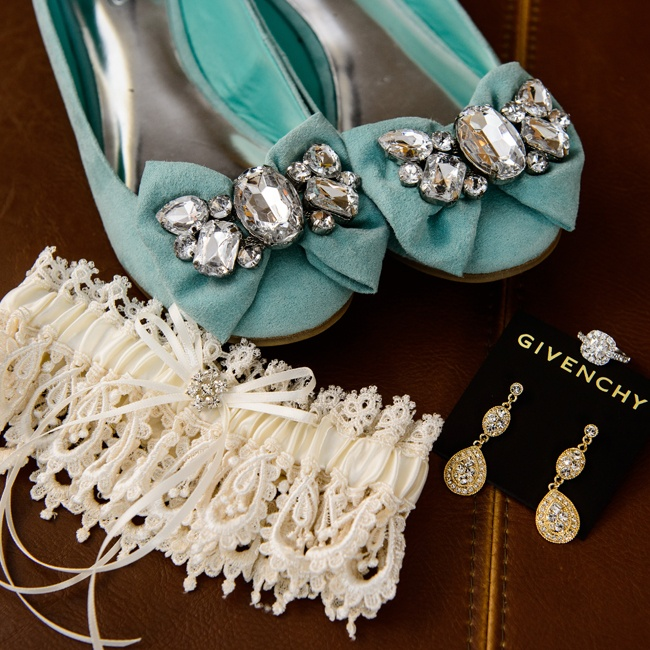 Lysa wore a glitzy pair of pale teal crystal and bow embellished flats under her elegant gown.