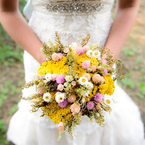 Lysa's bouquet of dried flowers had a rustic, vintage flair. The bouquet was filled with bright yellow yarrow flower and pops of pink thistle.