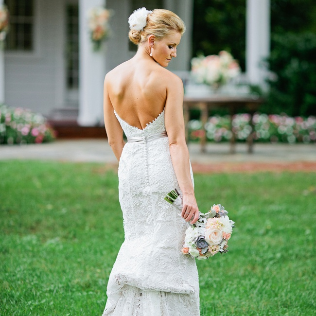 Monica wore an elegant A-line gown with an embroidered lace overlay, subtle one-point bustle and satin buttons down the back of the dress.