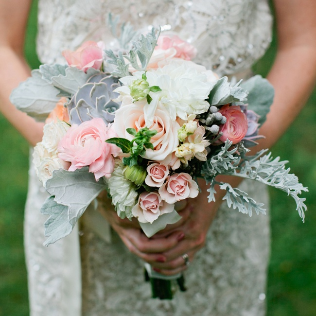 Dusty miller, lamb's ear, succulents and gray leucodendron berries added a whimsical flair to the romantic bouquet.