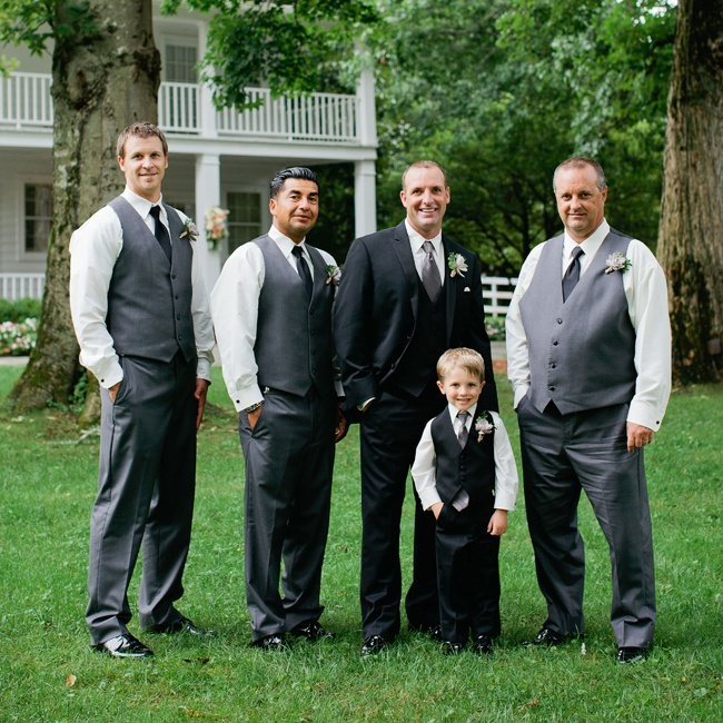EJ's groomsmen looked dapper in tailored grey slacks and matching vests, which they paired with sleek black ties. EJ stood out in a classic black three-piece suit.