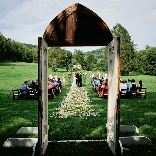 An old chapel door stood at the entrance of the ceremony for a rustic touch.