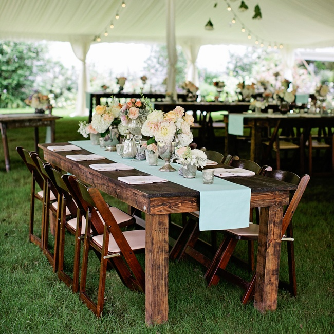 Vintage-inspired arrangements, a soft pastel color palette and rustic wood elements came together to create a reception that exuded southern elegance.