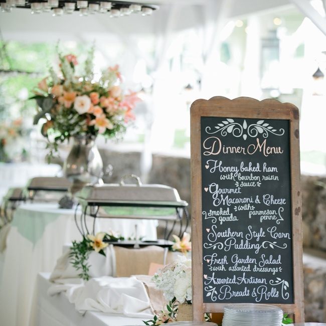 A southern style buffet offered up classic comfort foods during the reception. A rustic chalkboard sign outlined the evening's offerings.