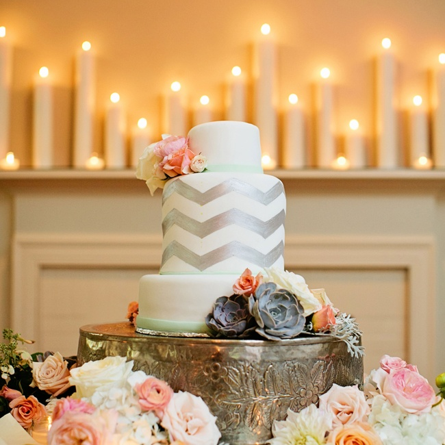 Monica and EJ's modern fondant cake featured silver chevron, mint green fondant ribbon and a cascade of pastel flowers.
