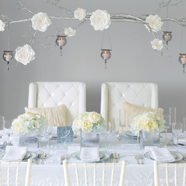 If you have a little room in the budget, you'll be able to go bugger on the style statements, like a rectangular table, multiple flower arrangements and larger (more expensive) linens. Upholstered chairs for the bride and groom cost less than a set of lounge furniture in the same look.