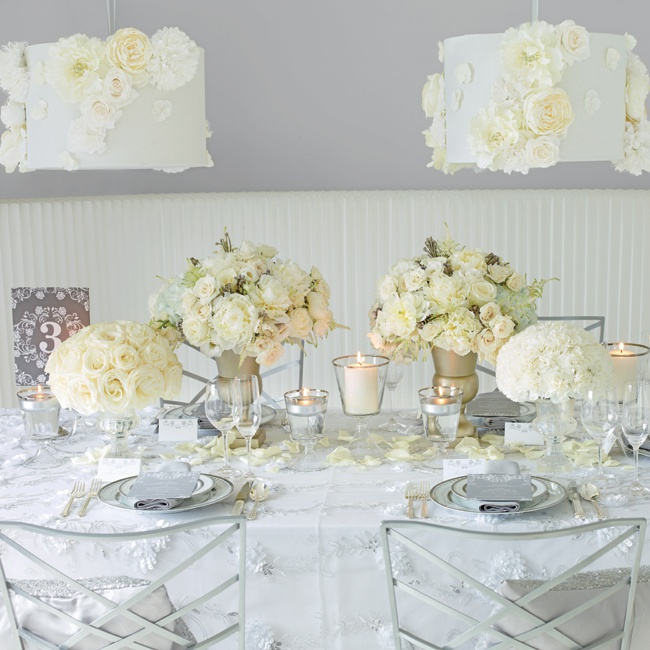 If you're not limited by a budget, this is your chance to customize (and upgrade) every element of your wedding from lighting to your bouquet. Flowers are now your best friend. A runner of lush blooms in mix-and-match vessels anchors the table.