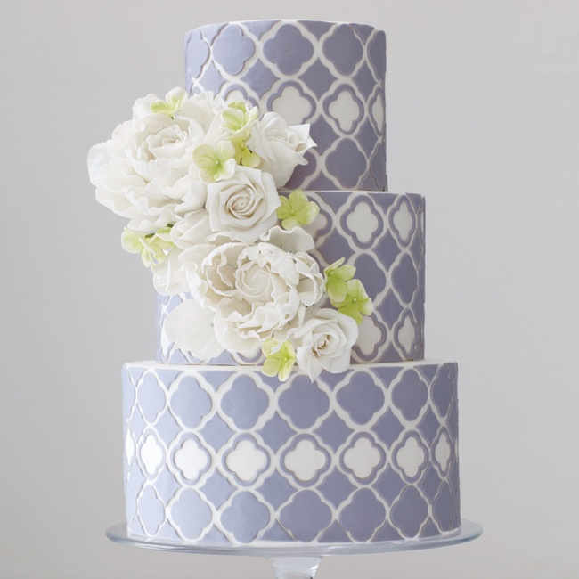 Cut and serve a large decorated cake complete with a cascade of sugar flowers over hand-cut patterned fondant.