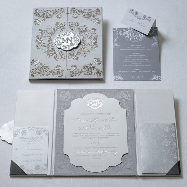 A tri-fold invitation with a metal clasp sets the tone for your opulent affair.