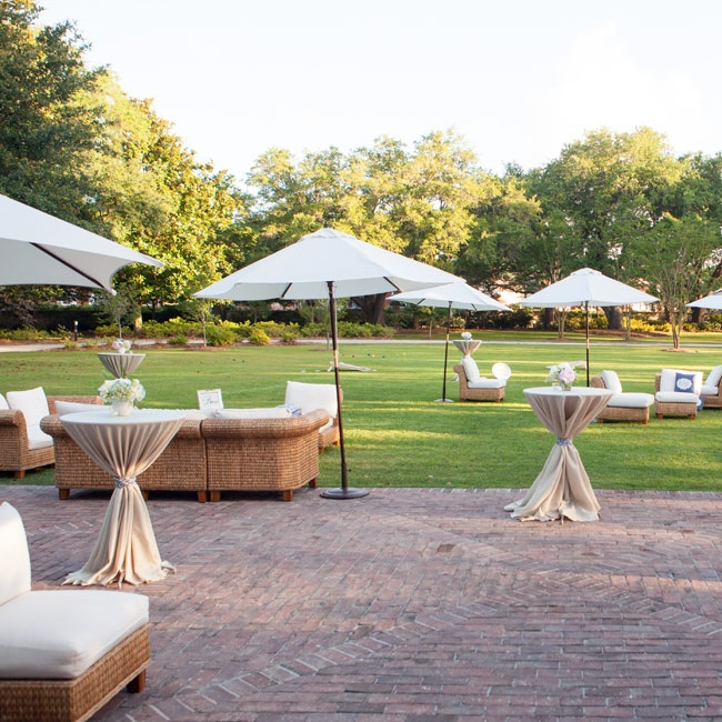 Wicker lounge furniture with plush white cushions dotted the plantation's grand lawn, setting a relaxed tone for the cocktail hour.