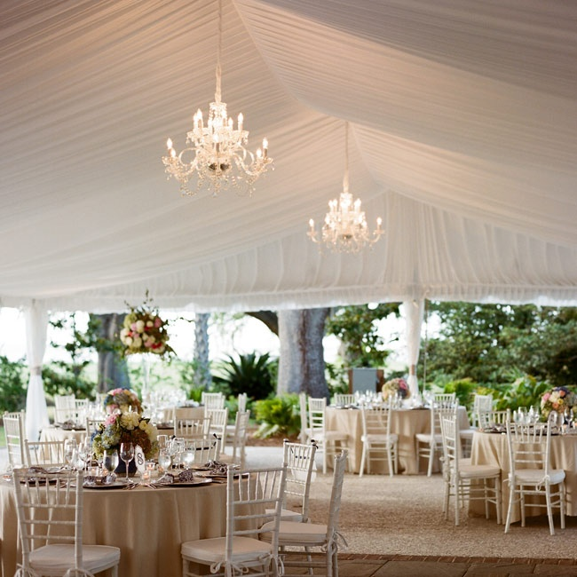 Airy linens and elegant chandeliers added a regal, romantic edge to the reception space.