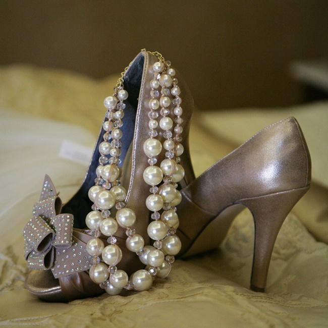 Katelyn chose a bold earthy metallic shoe with a peep-toe and bowed detailing and accessorized with pearls.