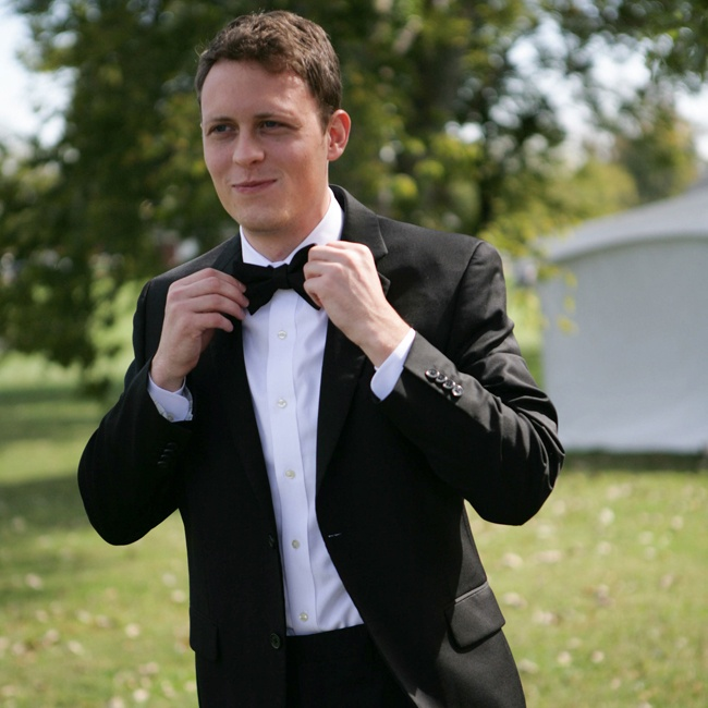 The groom wore a classic black and white tux by Alfani and accessorized with a bowtie.