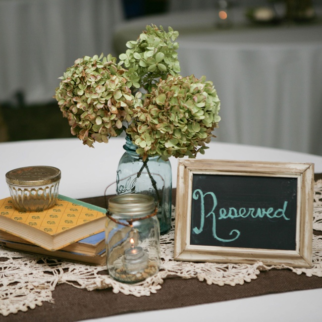 Reception decor was focused on earth tones, like these green hydrangea clusters.