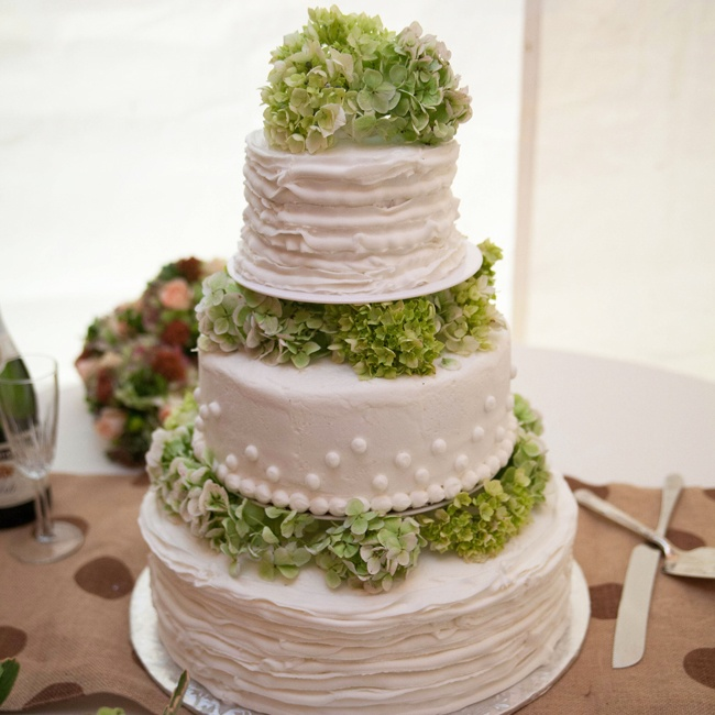 The couple's traditional white, round cake was broken up by tiers of fresh hydrangeas.