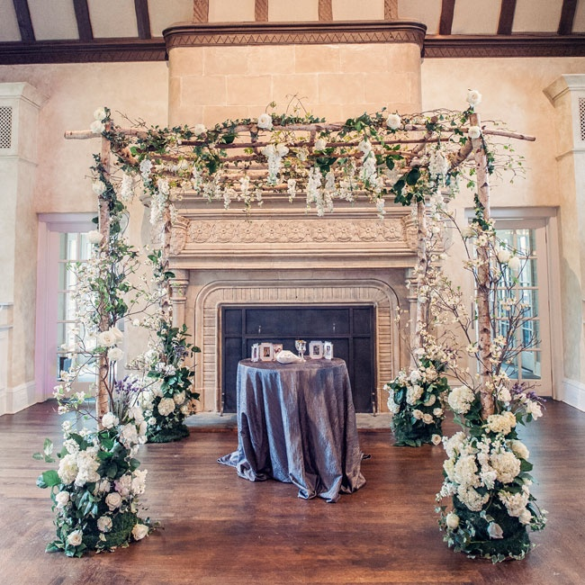 Jessica and Matthew were married underneath a traditional white floral huppah.