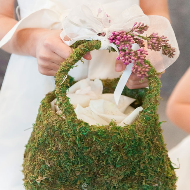 The three flower girls carried moss baskets to throw flower petals from.
