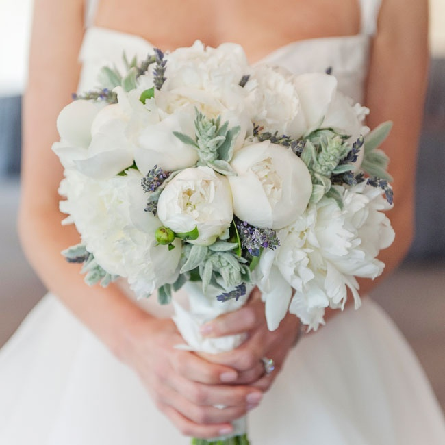 The bride's bouquet was a combination of white peonies, dusty miller and lavender.